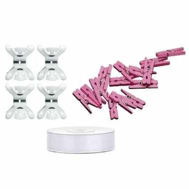 Baby geboortekaartjes ophangen pakket meisje roze speelgoed